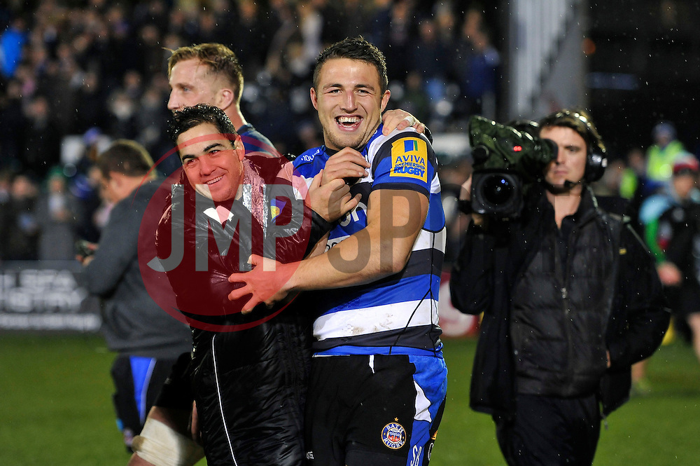 Sam Burgess of Bath Rugby is all smiles with team-mate Horacio Agulla after making his rugby union debut - Photo mandatory by-line: Patrick Khachfe/JMP - Mobile: 07966 386802 28/11/2014 - SPORT - RUGBY UNION - Bath - The Recreation Ground - Bath Rugby v Harlequins - Aviva Premiership