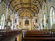 14 AUGUST 2014 - BANGKOK, THAILAND: Interior of Holy Rosary Church in the Talat Noi section of Bangkok. Holy Rosary Church, Wat Mae Phra Luk Prakham, is also known as Kalawar Church. The church was built with a land grant from King Rama I in 1786, about four years after Bangkok was established as Siam's capital. Many Catholic Vietnamese and Cambodians fled to Bangkok during the wars in Indochina and adopted this church as their main house of worship. It has been rebuilt twice. The present church was built in the late 1890s. The cream-colored church has a towering spire and European style stained-glass windows.    PHOTO BY JACK KURTZ