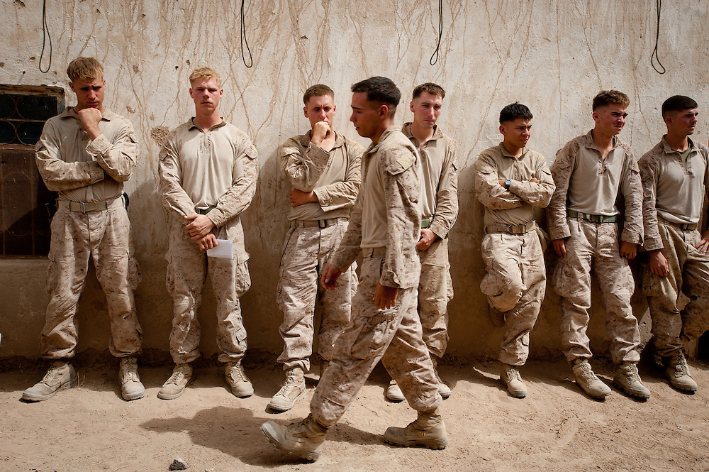 Marines attend a memorial service at COP Coutu for Lance Corporal Daniel Raney and Lance Corporal Timothy Serwinowski.