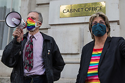 Veteran LGBT+ and human rights campaigner Peter Tatchell (l) and Jayne Ozanne of the Ban Conversion Therapy Coalition (r) address campaigners against LGBT+ conversion therapy after handing in a petition signed by 7,500 people at the Cabinet Office and Government Equalities Office calling on the government to fulfil a promise it made in July 2018 to ban the practice on 23rd June 2021 in London, United Kingdom. LGBT+ conversion treatments, which have been linked to anxiety, depression and self-harm, have been condemned by major UK medical, psychological and counselling organisations.