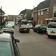 Voorbaan Huizen met geparkeerde auto's