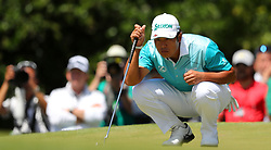 Hideki Matsuyama looks over his birdie putt attempt on the 1st hole during the third round of the Masters Tournament at Augusta National Golf Club in Augusta, Ga., on Saturday, April 8, 2017. (Photo by Curtis Compton/Atlanta Journal-Constitution/TNS) *** Please Use Credit from Credit Field ***