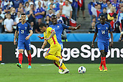 France Midfielder Paul Pogba tackles Romania Midfielder Nicolae Stanciu during the Group A Euro 2016 match between France and Romania at the Stade de France, Saint-Denis, Paris, France on 10 June 2016. Photo by Phil Duncan.