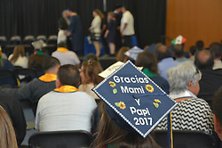 May 22, 2017 - Merced, CA, USA - A message in Spanish translating to ''Thanks Mom and Dad 2017'' is written on a graduate's cap as her peers walk up to receive their certificates during the Chicanx/Latinx Commencement Saturday, May 13, 2017, at the University of California Merced. The event was important because it celebrated family, organizer Alex Delgadillo told graduates. (Credit Image: © Vikaas Shanker/The Merced Sun Star via ZUMA)
