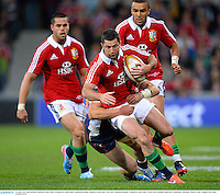 25 June 2013; Rob Kearney, British & Irish Lions, is tackled by Mitch Inma, Melbourne Rebels. British & Irish Lions Tour 2013, Melbourne Rebels v British & Irish Lions. AAMI Park, Olympic Boulevard, Melbourne, Australia. Picture credit: Stephen McCarthy / SPORTSFILE