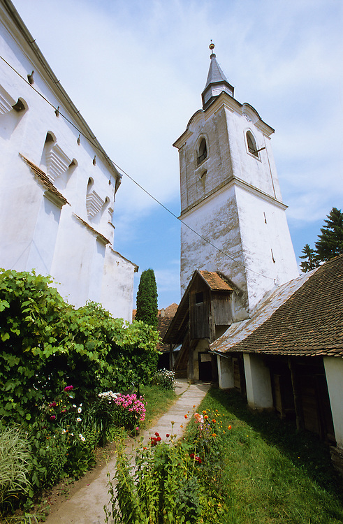 Exterior of a Saxon Unesco World Heritage Church at Dariju ( Szekelyderz ) Transylvania, Romania, with the storage area of the inside of the fortified walls. .<br /> <br /> Visit our ROMANIA HISTORIC PLACXES PHOTO COLLECTIONS for more photos to download or buy as wall art prints https://funkystock.photoshelter.com/gallery-collection/Pictures-Images-of-Romania-Photos-of-Romanian-Historic-Landmark-Sites/C00001TITiQwAdS8<br /> .<br /> Visit our MEDIEVAL PHOTO COLLECTIONS for more   photos  to download or buy as prints https://funkystock.photoshelter.com/gallery-collection/Medieval-Middle-Ages-Historic-Places-Arcaeological-Sites-Pictures-Images-of/C0000B5ZA54_WD0s