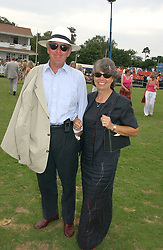 MR & MRS MICHAEL BUERK at the Queen's Cup polo final sponsored by Cartier at Guards Polo Club, Smith's Lawn, Windsor Great Park on 18th June 2006.  The Final was between Dubai and the Broncos polo teams with Dubai winning.<br /><br />NON EXCLUSIVE - WORLD RIGHTS