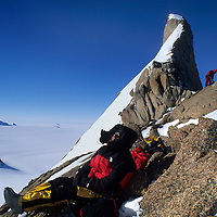 ANTARCTICA, Queen Maud Land. Expedition prepares to bivouac without sleeping bags on the Troll's Castle, Filchner Mtns.