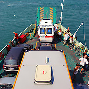 Ferry with tourists and bus to Lido island, Venice (Italy)