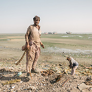 Fisherman, returning from 14 days at sea, complain about lack of fish near Karachi. Ibrahim Hyderi is a fisherman's village, once outside of Karachi, now part of the sprawling city and exposed to high level of pollution.