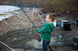 © Licensed to London News Pictures. <br /> 12/10/2014. <br /> <br /> Saltburn, United Kingdom<br /> <br /> Alfie Morris, 4, from Redcar holds onto his fishing rod during the annual Jim Maidens memorial beach fishing competition in Saltburn by the Sea in Cleveland. <br /> The competition is held each year to mark the death of Saltburn plumber and keen fisherman Jim Maidens who died in 1998 when he was killed after being swept overboard from his boat 'Corina' close to the beach at Saltburn.<br /> <br /> Photo credit : Ian Forsyth/LNP