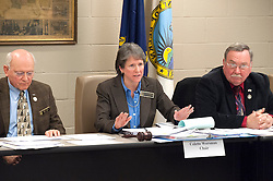 Belknap County delegation chairman Colette Worsman, flanked by Rep Herb Vadney and Richard Burchell, explains the hearing process during a meeting of the delegation at the county complex on Monday, January 21, 2013. (Alan MacRae/for the Laconia Daily Sun)