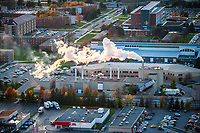 Steam rises from the power plant at Central Michigan University.