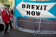 Protester wearing a crown hangs up his Brexit Now banner outside The Supreme Court as the second day of the hearing to rule on the legality of suspending or proroguing Parliament begins on September 18th 2019 in London, United Kingdom. The ruling will be made by 11 judges in the coming days to determine if the action of Prime Minister Boris Johnson to suspend parliament and his advice to do so given to the Queen was unlawful.