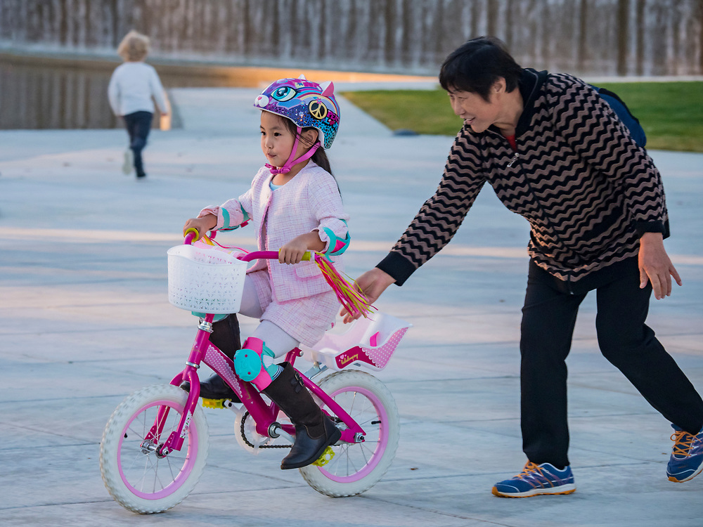 United States, Washington, Bellevue. Downtown Park. Asian children learning to ride bikes. Editorial Use Only.