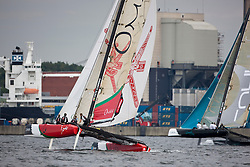 """© Sander van der Borch. Kiel - Germany, 27th of August 2009. iShares cup. Practice day...The first day of racing as part of the media day. the teams practice on the inland canal close to the city centre. The picture shows the Oman Sail extreme 40 """"Masirah""""."""
