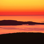 The very first light of a new day at the Easternmost point of the US, the summit of Cadillac Mountain, Acadia National Park, Maine.