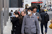 As Londoners await the imminent second coronavirus lockdown it's business as usual in the West End with large numbers of people, some wearing face masks and some not, coming to Oxford Street to go shopping on what will be the last weekend before a month-long total lockdown in the UK on 1st November 2020 in London, United Kingdom. The three tier system in the UK has not worked sufficiently, to suppress the virus, and there have have been calls by politicians for a 'circuit breaker' complete lockdown to be announced to help the growing spread of the Covid-19.