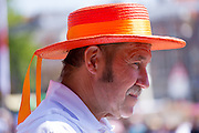Cheese Father, head of Cheese Carriers Guild, in traditional hat at Alkmaar cheese market, The Netherlands