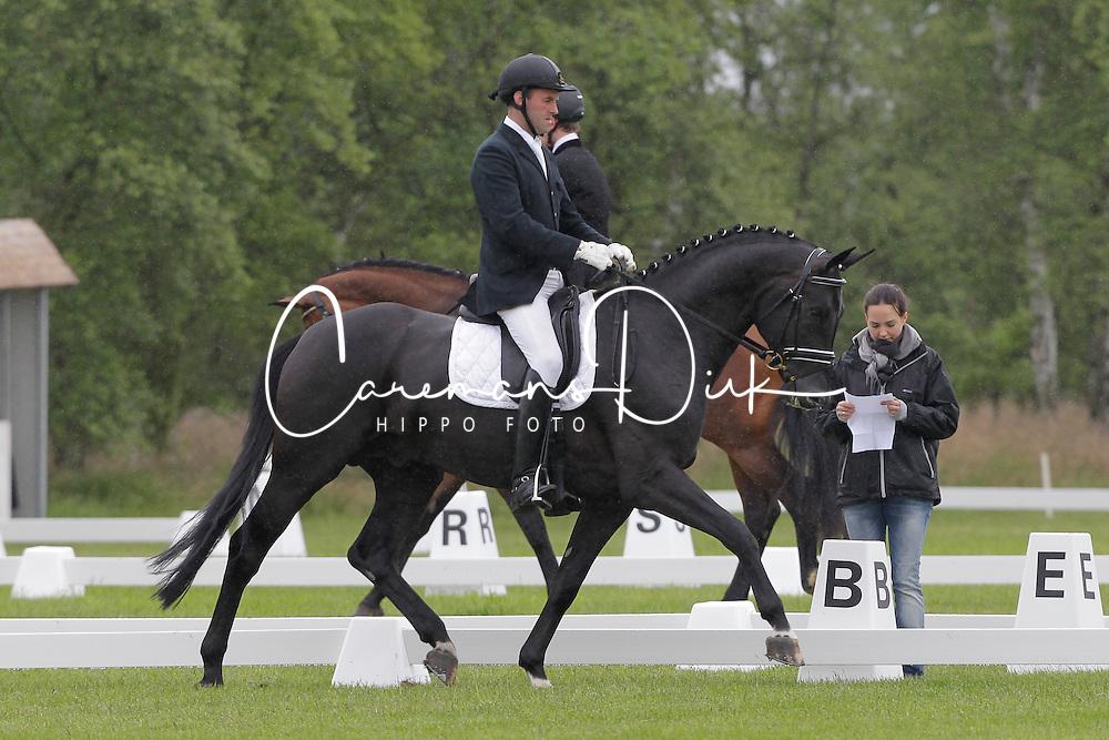 Van Laer Nick (BEL) - Sir Donovan<br /> 5j dressuur open<br /> Nationale wedstrijd LRV jonge paarden - Lommel 2012<br /> © Dirk Caremans