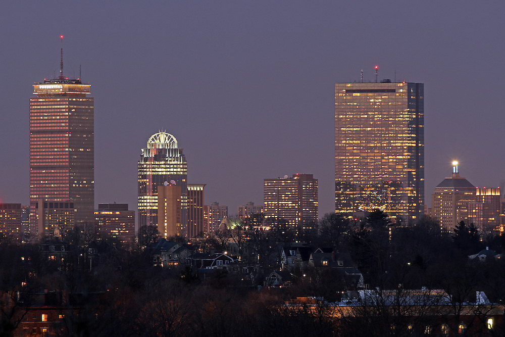 Boston skyline picture photos are available as museum quality photography prints, canvas prints, acrylic prints or metal prints. Prints may be framed and matted to the individual liking and decorating needs:<br /> <br /> http://juergen-roth.artistwebsites.com/featured/boston-skyline-from-jamaica-plain-juergen-roth.html<br /> <br /> City of Boston skyline photography at twilight showing landmarks such as John Hancock building, Prudential Center and Jamaica Plain in the foreground. Photographed from Bussey Hill in the Boston Arnold Arboretum.