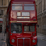 Red Routemaster parked in a London street.<br />