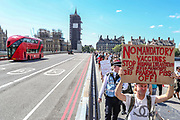 "A group of protestors who appears to be against 5G network, against the pandemic outbreak, as well as a vaccine solution, are seen protesting over the Westminster Bridge on Monday, June 22. 2020. They also said that government lockdown rules that aim to curb the spread of coronavirus outbreak quote: ""are a farse that should be challenged."" The group appears to willingly challenge the two-metre social distancing rule, which will be under review as the UK relax coronavirus lockdown measures implemented to stem the spread of the virus. (Photo/ Vudi Xhymshiti)"