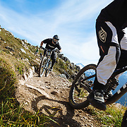 Four mountain bikers ride the epic Top of The World trail in Whistler, British Columbia