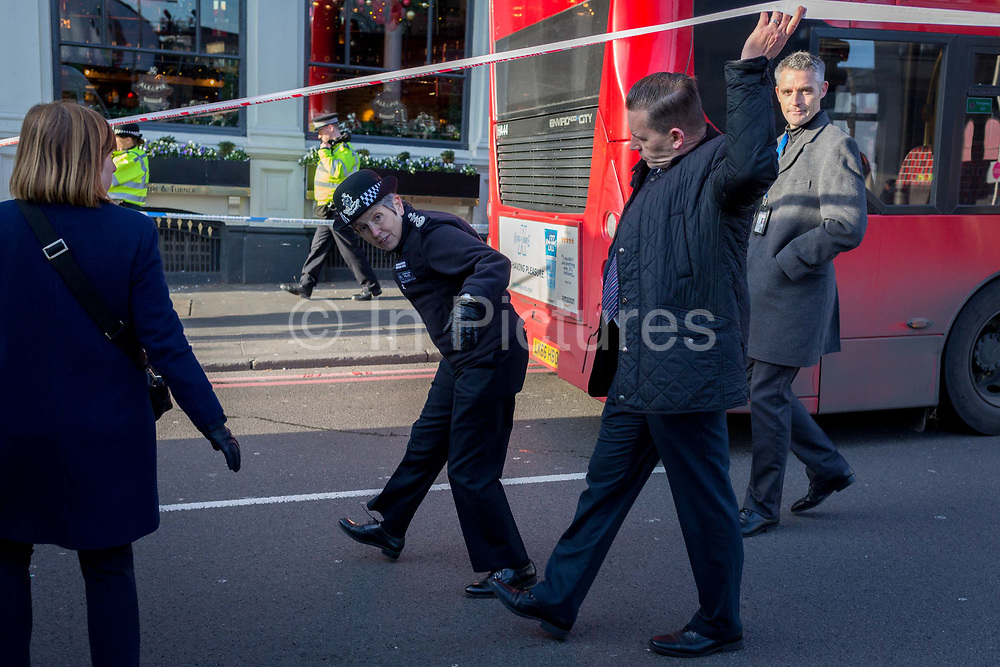 The morning after the terrorist attack at Fishmongers Hall on London Bridge, in which Usman Khan a convicted, freed terrorist killed 2 during a knife a attack, then subsequently tackled by passers-by and shot by armed police - Met Police Commissioner Cressida Dick leaves the cordon at the southern end of the bridge before touring Borough Market, on 30th November 2019, in London, England.