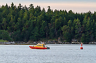 The Royal Canadian Marine search and rescue boat J.C. McGregor (RCM-SAR 27) passes Newcastle Island in Nanaimo Harbour, Nanaimo, British Columbia, Canada