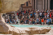 Tourists gather around the Trevi fountain on July 28, 2017 in Rome, Italy. Rome has suffered from worsening drought since March so as of tomorrow the municipality has decided to take action and ration the distribution of water to citizens, with 8 hour delivery blocks to each area. ©Simone Padovani