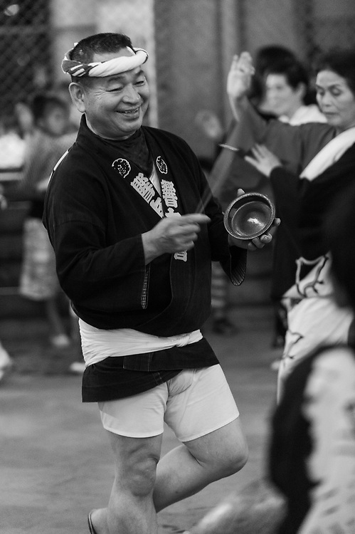 Obon festival, Ukima, Tokyo, Japan, August 22, 2009. Obon festival, Ukima, Tokyo, Japan, August 21, 2009. Obon is the Buddhist festival of the dead. Celebrations can include dancing and taiko drumming, such as this small event under the train tracks near a small station in Tokyo's Kita Ward.