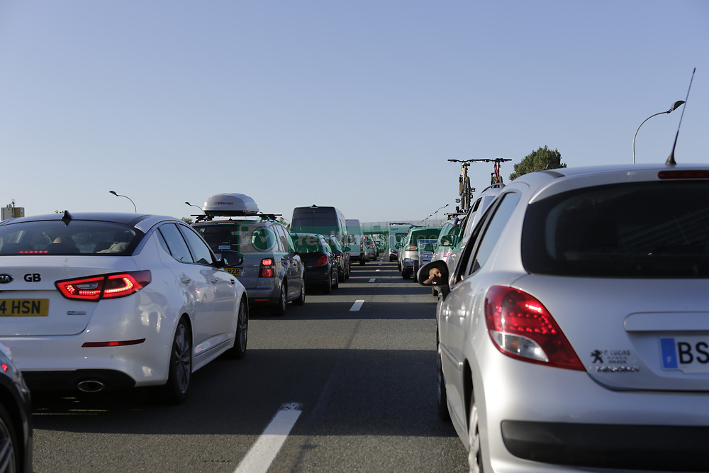 September 2, 2017 - Calais, Hauts-de-France, France - A traffic jam as developed on the approach road to the Calais port. Refugees are back in Calais, nearly a year after the refugee camp known as The Jungle was dismantled by the French State and the refugees were being sent to reception centres all over France. The refugees are still trying to reach the UK. One way they are trying is to enter trucks on the Route national 216, the approach road that leads to the port of Calais and the ferries going to the UK, when the traffic has stopped on the road. (Credit Image: © Michael Debets/Pacific Press via ZUMA Wire)