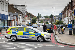 © Licensed to London News Pictures. 18/08/2018. Catford, UK. Police officers man a cordon near a property where a man in his 50's has been stabbed to death in Catford, south London. Police were called at 4am, the victim was pronounced dead at the scene at 5.28am. No arrests have been made. Photo credit: Peter Macdiarmid/LNP