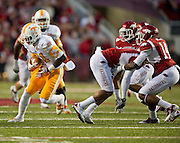 Nov 12, 2011; Fayetteville, AR, USA;  Tennessee Volunteers wide receiver Da'Rick Rogers (21) carries the ball past Arkansas Razorbacks safety Eric Bennett (14) and other defenders during a game at Donald W. Reynolds Razorback Stadium. Arkansas defeated Tennessee 49-7. Mandatory Credit: Beth Hall-US PRESSWIRE