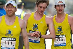 2013 Boston Marathon: BAA teammates celebrate together after finishing: Ryan McCalmon, Ian Nurse, Peter Gilmore,