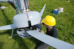 Man erecting a wind turbine system at Rushcliffe country park,