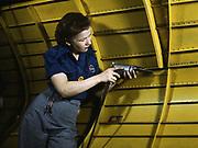 World War II 1939-1945:  Woman working on a 'Vengeance' dive bomber,  using a hand drill;  Vultee-Nashville, Tennessee, USA, 1943. Labour Female War Effort