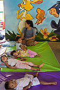 "19 FEBRUARY 2008 -- SANGKLABURI, KANCHANABURI, THAILAND: Toddlers sleep in the nursery at Baan Unrak Children's Home in Sangklaburi, Thailand. Baan Unrak children's home and school, established in 1991 in Sangklaburi, Thailand, gives destitute children and mothers a home and career training for a better future. Baan Unrak, the ""Home of Joy,"" provides basic needs to well over 100 children, and  abandoned mothers. The home is funded by donations and the proceeds from the weaving and sewing shops at the home. The home is a few kilometers from the Burmese border. All of the women and children at the home are refugees from political violence and extreme poverty in Burma, most are Karen hill tribe people, the others are Mon hill tribe people. The home was started in 1991 when Didi Devamala went to Sangklaburi to start an agricultural project. An abandoned wife asked Devmala to help her take care of her child. Devmala took the child in and soon other Burmese women approached her looking for help.    Photo by Jack Kurtz"