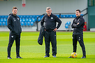 (LtoR) Heart of Midlothian coach Jon Daly, Heart of Midlothian manager Craig Levein and coack Liam Fox watch the team train at The Oriam Sports Performance Centre, Heriot Watt University, Edinburgh, Scotland on 24 September 2019, ahead of the Betfred Scottish Football League Cup quarter-final match against Aberdeen. Picture by Malcolm Mackenzie