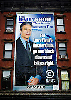 Just around the corner from The Daily Show's studio in New York City one can find this building advertisement.