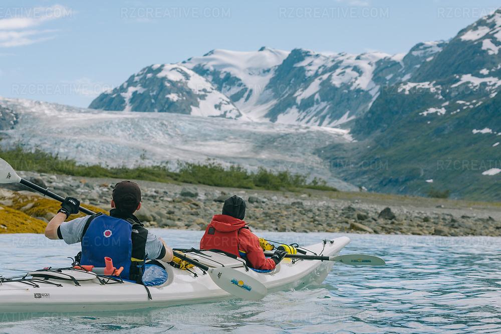 Kayakers paddle near Reid Glacier in Alaska's Glacier Bay National Park. Photo © Robert Zaleski / rzcreative.com