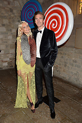 POPPY DELEVINGNE and JAMES COOK at Save the Children's spectacular, black tie Winter Gala, a festive fundraising event held at London's Guildhall. Guests were transported into the magical world of the much-celebrated British novelist, Roald Dahl, in celebration of his centenary, for a marvellous evening of fine dining and gloriumtious entertainment to raise money to help transform children's lives across the world and here in the UK.