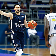 Anadolu Efes's Dogus Balbay (L) during their Turkish Basketball league derby match Fenerbahce Ulker between Anadolu Efes at the Ulker Sports Arena in Istanbul, Turkey, Monday, April 29, 2013. Photo by Aykut AKICI/TURKPIX