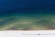 6-10-2010. Arial view of an empty beach on a Sunday at Orange Beach Alabama due to BP oil washing up on the shore .