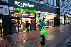 © Licensed to London News Pictures. 04/03/2021. London, UK. A customers is drinking king coffee bought from the first AMAZON GO grocery store in the UK opening today in Ealing, West London. Shoppers need to use app to shop inside the store and pick up groceries without stopping to pay. Photo credit: London News Pictures