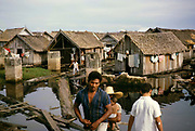 Informal housing wooden shacks built on timber logs known as the Floating City, Manaus, Brazil 1962