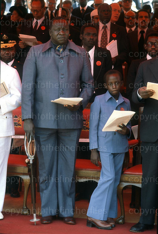 President Idi Amin seen with his son Moses at the funeral of President Jomo Kenyatta in Nairobi, Kenya in September 1978. Photograph by Terry Fincher
