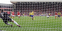 Photo: Paul Thomas.<br /> Barnsley v Southampton. Coca Cola Championship. 19/08/2006.<br /> <br /> Grzegorz Rasiak (C) of Southampton sends Barnsley keeper Nick Colgan the wrong way to score his second goal.