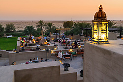 Dusk at rooftop bar at Bab al Shams desert hotel and resort in Dubai United Arab Emirates